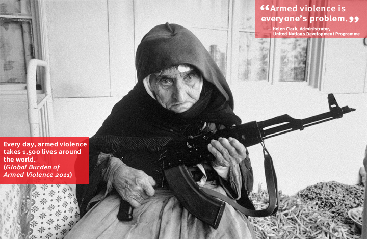 Armenia: A 106-year-old woman sits in front of her home guarding it with a rifle, in Degh village, near the southern city of Goris. Armed conflicts took place in and around nearby Nagarno-Karabakh, a disputed territory in Azerbaijan. Photo: UN